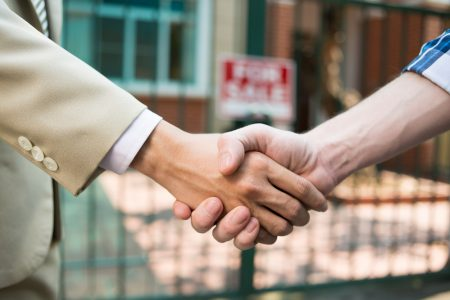 property developer handshake house sale